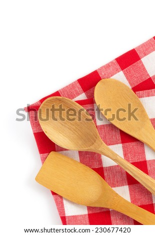 wooden kitchen tools at cloth napkins isolated on white background - stock photo