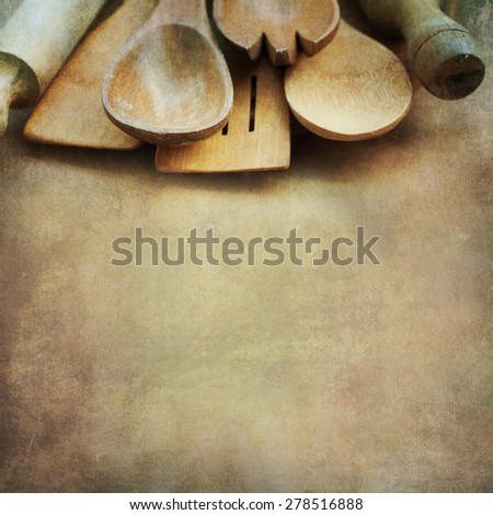 Wooden kitchen tools on vintage wooden background