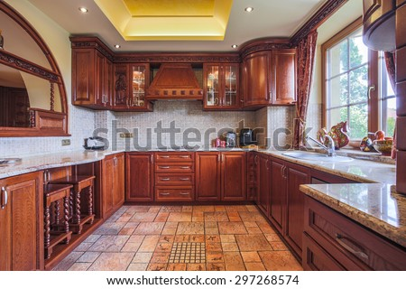 Wooden kitchen unit in colonial style interior