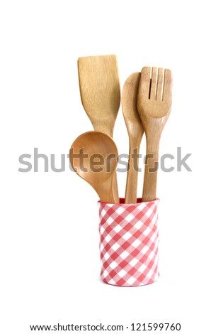 Wooden kitchen utensils in container isolated on white