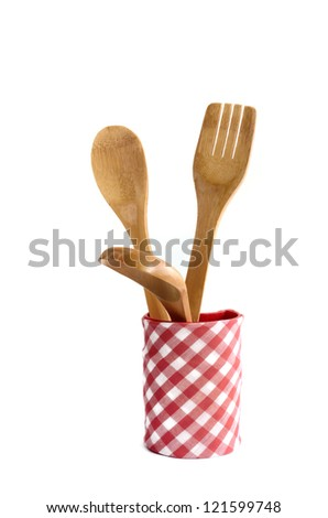 Wooden kitchen utensils isolated on white - stock photo