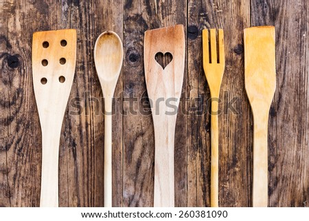 Wooden kitchen utensils wooden table. - stock photo