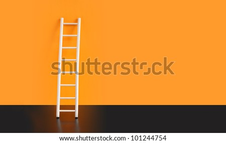 Wooden ladder on black floor against orange wall. Nice background with free space for text - stock photo
