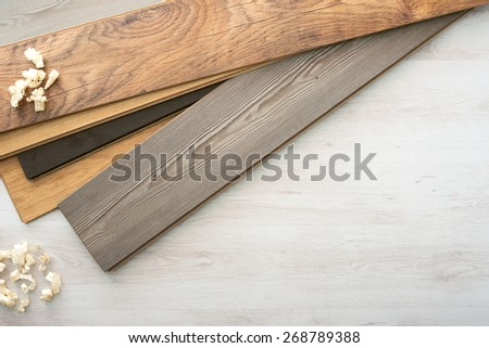 Wooden laminate parquet flooring choice color set with wooden shavings, top view - stock photo