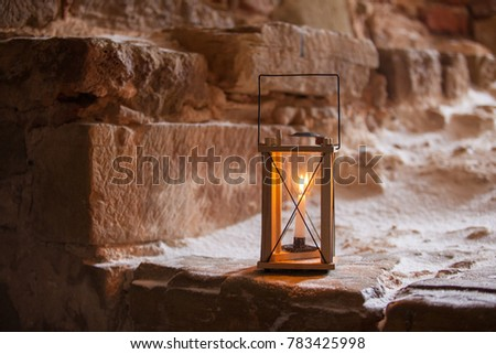 Wooden lantern with candle inside