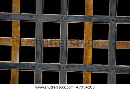 Wooden lattice on a black background