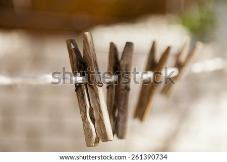 Wooden laundry buckles used to hang cloth to dry - stock photo