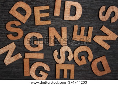 wooden letters forming word Design