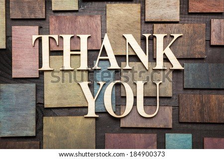 Wooden letters forming words THANK YOU written on wooden background