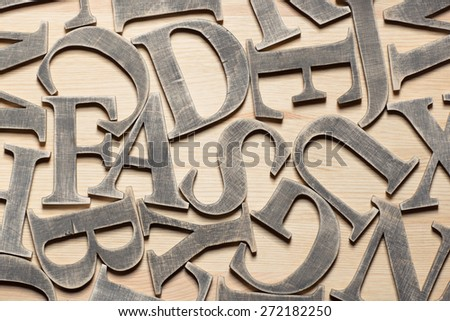 Wooden letters on wooden background - stock photo