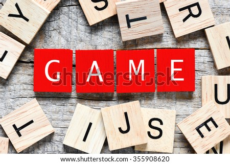 Wooden letters spelling game - stock photo