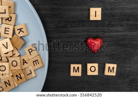 Wooden letters spelling I love mom - stock photo