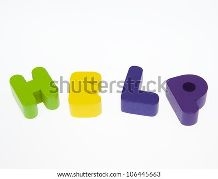 "Wooden letters spelling the word  ""help""  on white background."