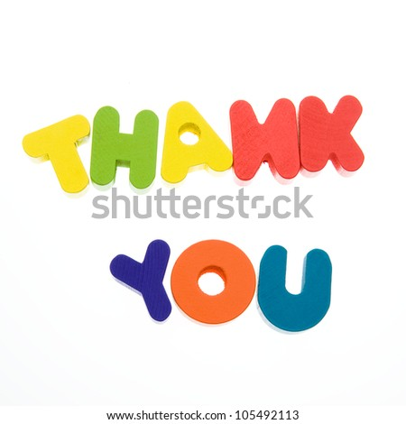 "Wooden letters spelling the word  ""thank you""  on white background."