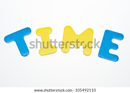 """Wooden letters spelling the word  """"time""""  on white background. - stock photo"""