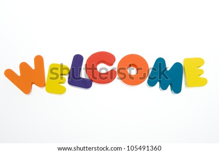 """Wooden letters spelling the word  """" welcome """"  on white background. - stock photo"""