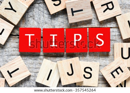 Wooden letters spelling tips - stock photo