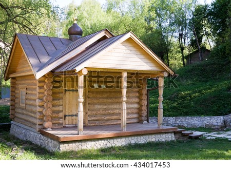 Wooden log house on a Sunny day.
