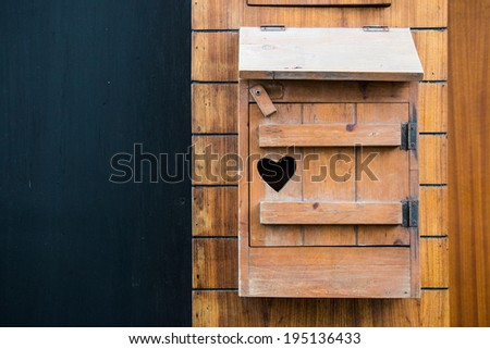Wooden mailbox with heart shape with copy writing space