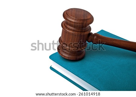 Wooden mallet and book on a white background