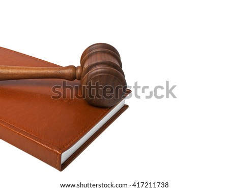 Wooden mallet and book on a white background - stock photo