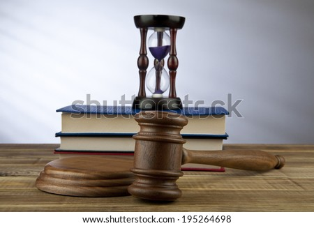 wooden mallet and books on a grey background