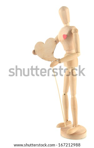 Wooden mannequin holding heart isolated on white - stock photo