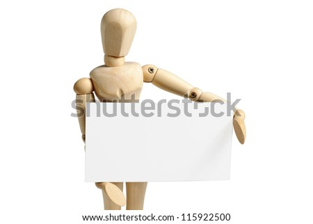 Wooden mannequin holds in hand a blank business card isolated on white background