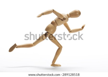 Wooden mannequin in intense sprint on a white background - stock photo