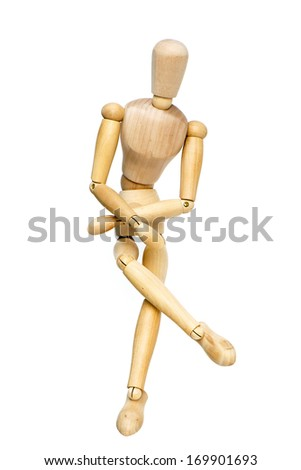 Wooden mannequin posing on white background