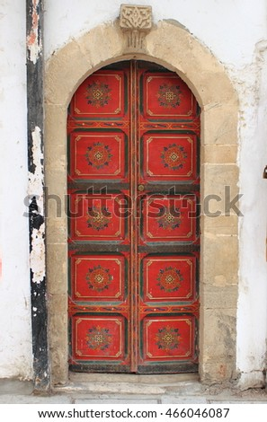 Wooden medieval arched style front door