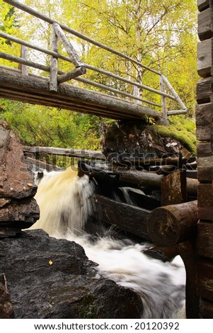 Wooden mill over a river in autumn, Finland