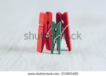 Wooden mini clothes pins - stock photo