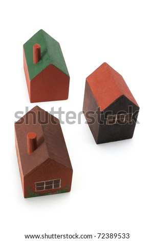 Wooden Miniature Houses on White Background