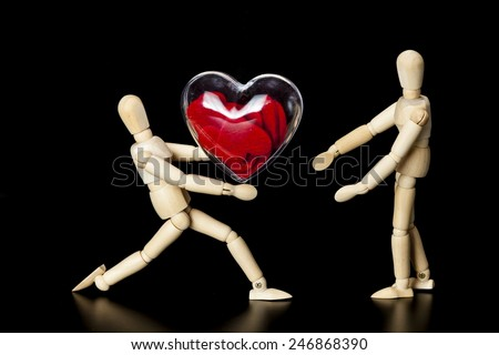Wooden model gives heart - stock photo
