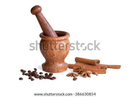 wooden mortar, star anise, cinnamon, coffee on a white background - stock photo