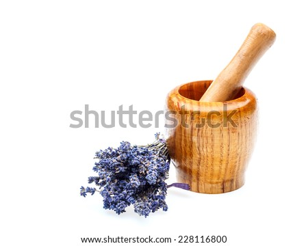 Wooden mortar with dry lavender flowers over white background  - stock photo