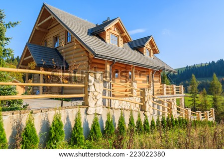 Wooden mountain house built from wood logs on sunny day, Pieniny Mountains, Poland - stock photo