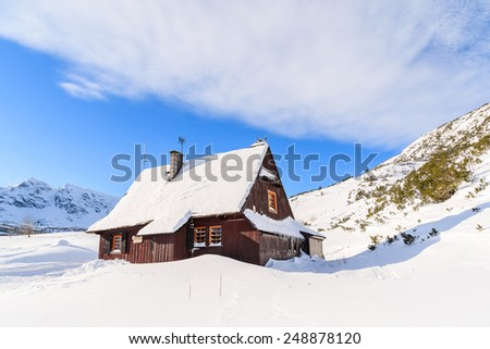 Wooden mountain hut in winter landscape of Gasienicowa valley, Tatra Mountains, Poland - stock photo