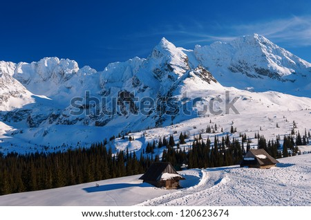 Wooden mountain huts in Gasienicowa valley in winter, Tatra Mountains, Poland - stock photo