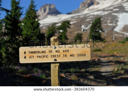 Wooden mountains trail pointer with Mount Hood in the background. Oregon, USA Pacific Northwest. - stock photo