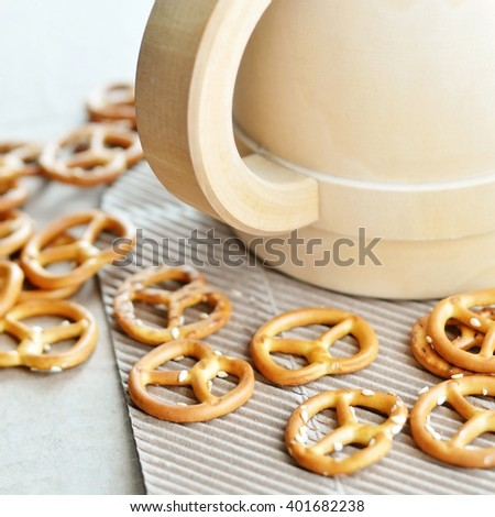 wooden mug and pretzels. close-up photography - stock photo