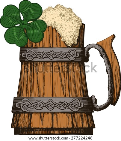 Wooden mug of beer with foam Irish, Celtic pattern. four leaf clover - stock photo