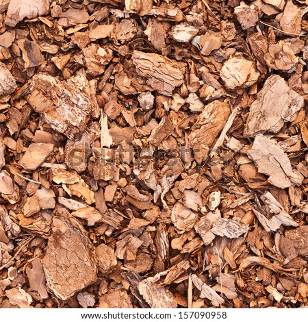 Wooden mulch ground fragment as abstract background composition - stock photo
