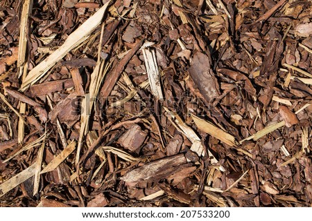 Wooden mulch ground's fragment as an abstract background composition - stock photo