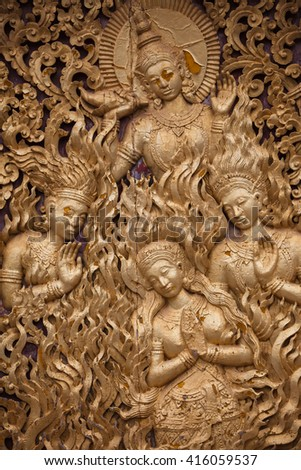 wooden mural in the temple of Laos