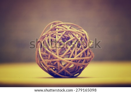 Wooden natural interior decorative wicker balls. Bright abstract background. Filter style instagram - stock photo