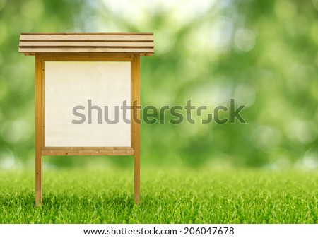 wooden notice board in a public park - stock photo
