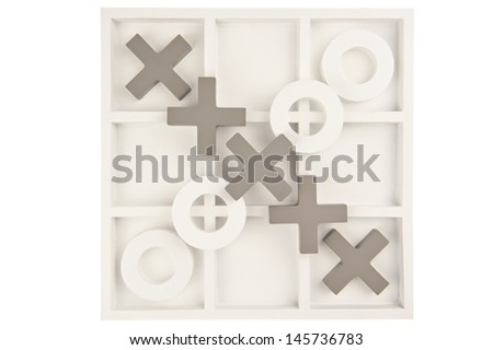 Wooden noughts and crosses game board in gray and white colors and ornate stones isolated in white background
