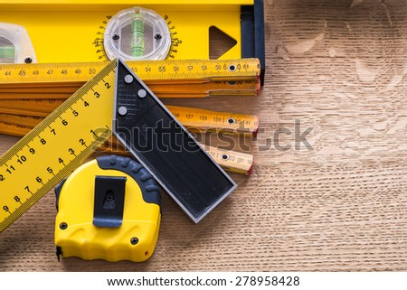 Wooden oaken board with objects of measurement construction concept  - stock photo